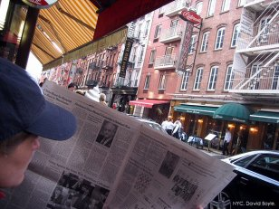 640px-2006_newspaper_reader_NYC_277350696